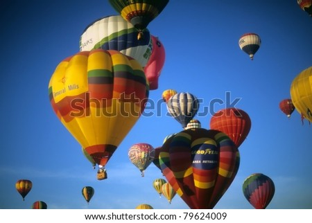ALBUQUERQUE - OCT 8 -  Tourists ride hot air ballons during a mass ascension at the International Balloon Festival,  on Oct 8, 1992 in Albuquerque, New Mexico - stock photo