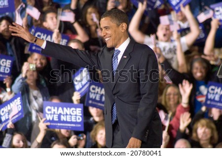 ALBUQUERQUE – OCT 25: US Presidential candidate, Barack Obama, gestures while smiling at a rally at the University of New Mexico on October 25, 2008 in Albuquerque. - stock photo
