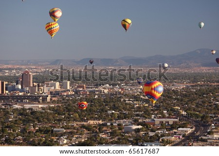 ALBUQUERQUE - OCTOBER 9: Balloons fly over Albuquerque on October 9, 2010 in Albuquerque, New Mexico. Albuquerque balloon fiesta is the biggest balloon event in the the world. - stock photo