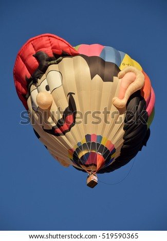 ALBUQUERQUE - OCTOBER 7: Special shapes hot air balloons take flight during the International Balloon Fiesta in Albuquerque NM on October 7, 2016