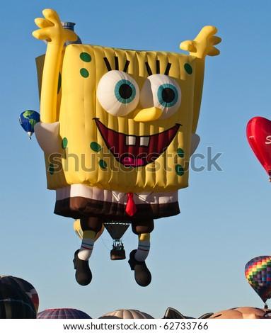 ALBUQUERQUE - OCTOBER 9: Sponge Bob balloon flying at the 2010 Albuquerque International Balloon Fiesta the morning of October 9, 2010 in Albuquerque, NM. - stock photo