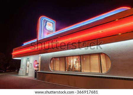 ALBUQUERQUE, USA - 1950's style Attention grabbing neon signage of 66 Diner on Historic Route 66 illuminated at night on September 19, 2015, Albuquerque New Mexico USA.