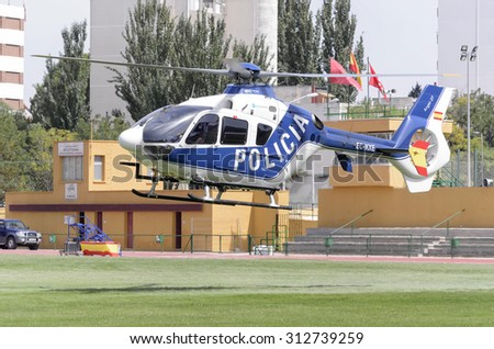 ALCALA DE HENARES, SPAIN - AUGUST 29th 2015: Helicopter of spanish police is taking off, after a show of spanish armed forces, in Alcala de Henares, on August 29th 2015. - stock photo