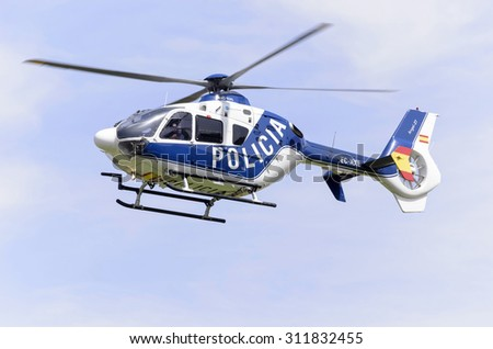 ALCALA DE HENARES, SPAIN - AUGUST 29th 2015: Helicopter, of spanish police, is taking off after an exhibition, in Alcala de Henares, on August 29th 2015. - stock photo