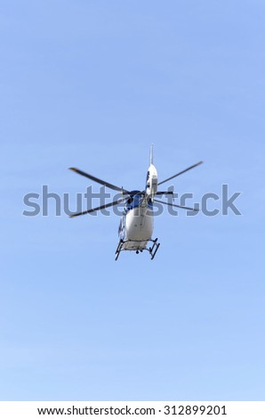 ALCALA DE HENARES, SPAIN - AUGUST 29th 2015: Helicopter of spanish police,is taking off with parachutists inside,during an exhibition of spanish armed forces, in Alcala de Henares, on August 29th 2015 - stock photo