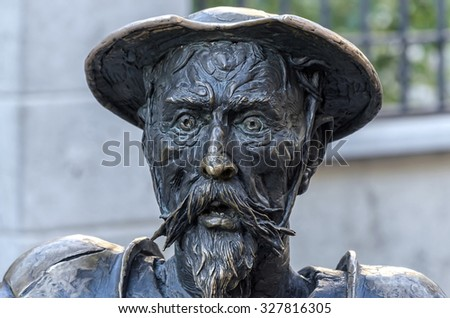 ALCALA DE HENARES, SPAIN - OCTOBER 9th 2015: Iron sculpture of -Don Quijote-,located in street,at doors of Miguel de Cervante's house,during Cervantes's week,in Alcala de Henares,on October 9th 2015 - stock photo
