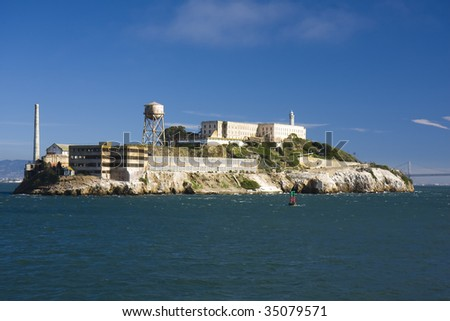 Alcatraz island from the sea with a blue sky