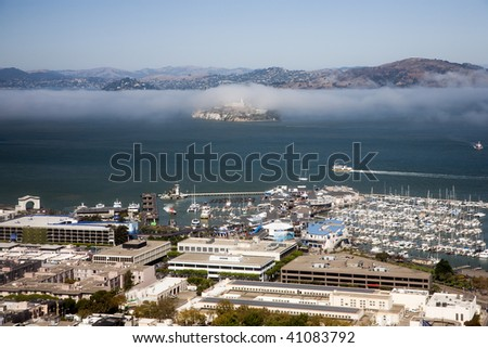 Alcatraz Island is located in the middle of the San Francisco Bay. - stock photo