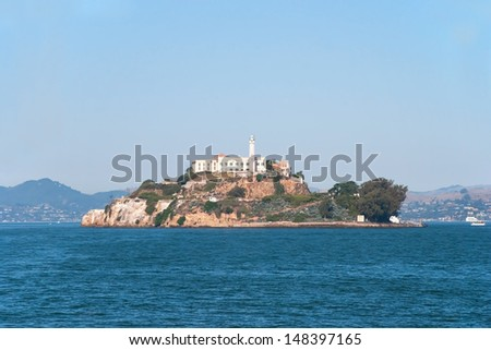 Alcatraz jail island in San Francisco bay with a beautiful blue sky in background - stock photo