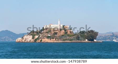 Alcatraz jail island in San Francisco bay with a beautiful blue sky in background panorama - stock photo