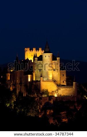 Alcazar fortress at night, Segovia, Castile and Leon, Spain - stock photo