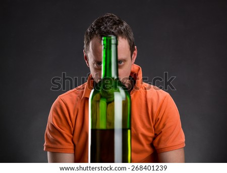 Alcohol addict - stock photo