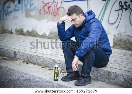 alcohol and man on the street - stock photo