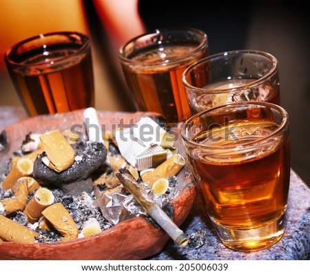 Alcohol and smoking - stock photo