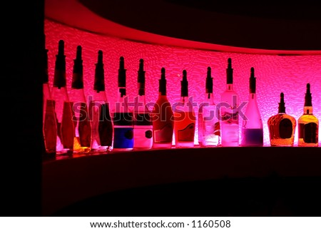 Alcohol bottle at a bar / night club. - stock photo