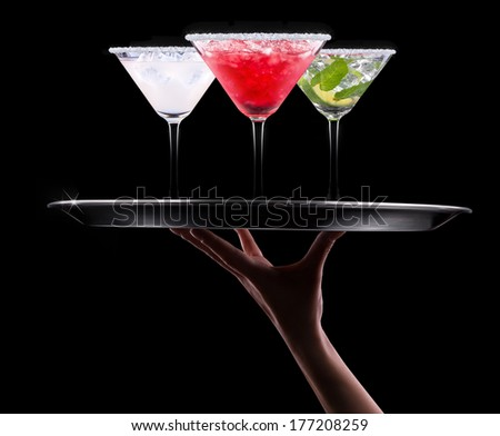 alcohol cocktail set on a waiter tray - stock photo