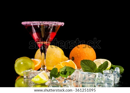 alcohol cocktail set with tasty summer fruits. - stock photo