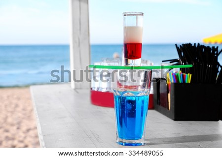 Alcohol cocktails on beach bar counter, close up - stock photo