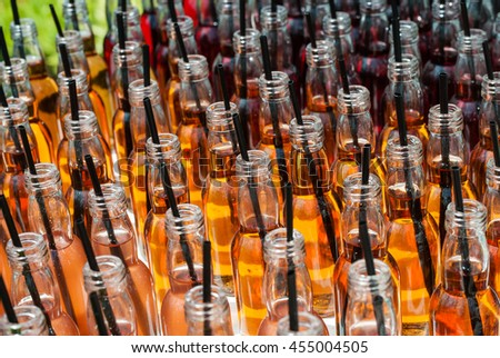 Alcohol cocktails, shots in glass bottles. Row of many alcohol tasty shots with straws in small bottles. Creative cocktails. Unusual alcohol in bar, many, plenty of drinks for party.,  - stock photo