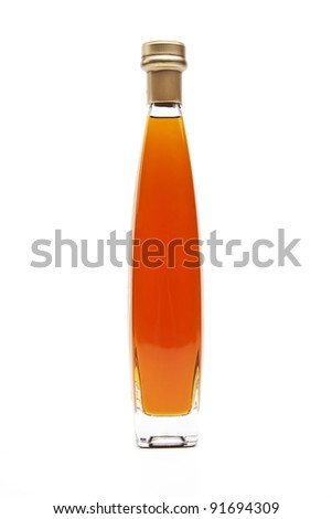 Alcohol cognac in a closed bottle on white background - stock photo