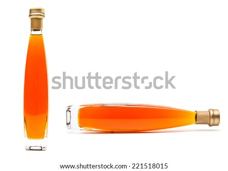 Alcohol cognac in a closed bottles - stock photo