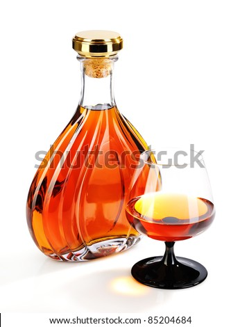 Alcohol cognac in bottles with a glass on white background - stock photo