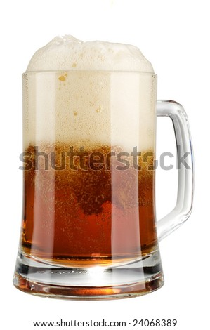 Alcohol dark beer glass with froth isolated on a white background.