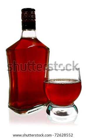 alcohol drink is in a bottle and glass isolated on white background - stock photo