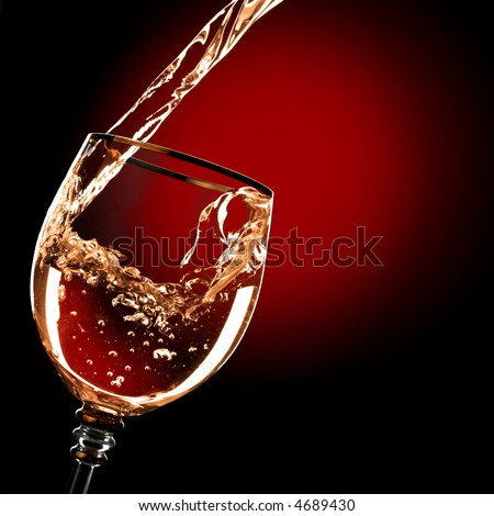 Alcohol drink pours into the glass - stock photo