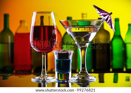 Alcohol drinks and cocktails on bar - stock photo
