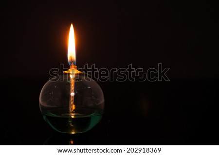 Alcohol lamp lighting on the darkness  - stock photo