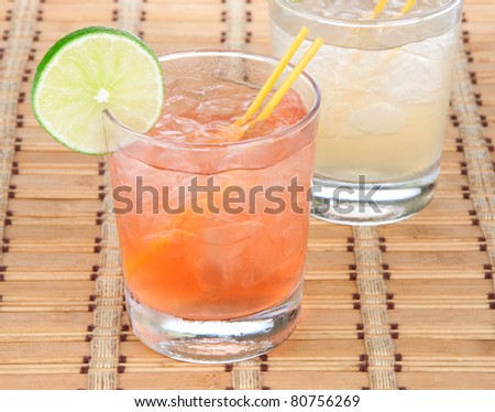 Alcohol long island Iced tea cocktails with lime - stock photo