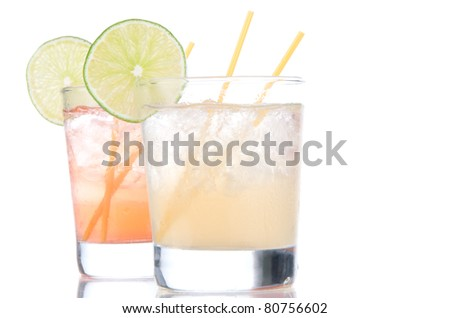 Alcohol long island Iced tea cocktails with lime in short cocktail glasses isolated on a white background - stock photo