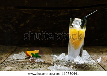 Alcohol Orange Shot Drink with copyspace, on brown wooden board. - stock photo