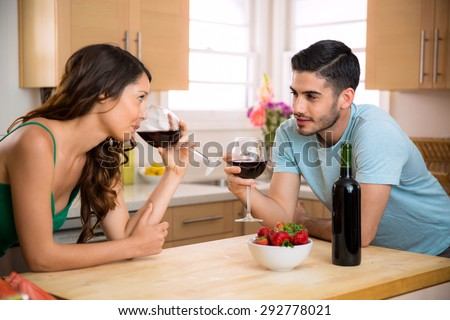 Alcohol red wine lightens the mood and breaks the ice for two people on a date - stock photo