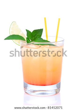 Alcohol tequila sunrise cocktail with crushed ice, green mint, yellow straws, lime in small glass isolated on white background - stock photo