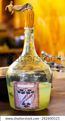 Alcohol tincture of radish for sale on rustic country fair - stock photo