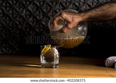 alcohol to fill the cup on the wooden table