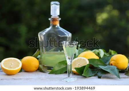 Alcohol. Traditional Italian liqueur limoncello. Sweet lemon drink. - stock photo