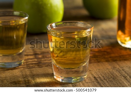 Alcoholic Apple Flavored Bourbon Whiskey in a Shot Glass