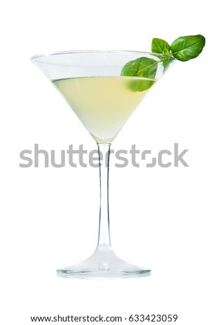 Alcoholic cocktail in martini glass with basil, isolated on white background