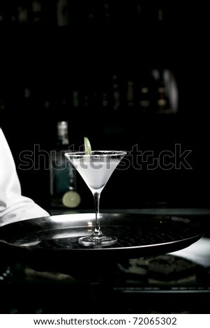 Alcoholic Cocktail Made of Tequila Mixed and Lemon Juice. Served with lime. - stock photo