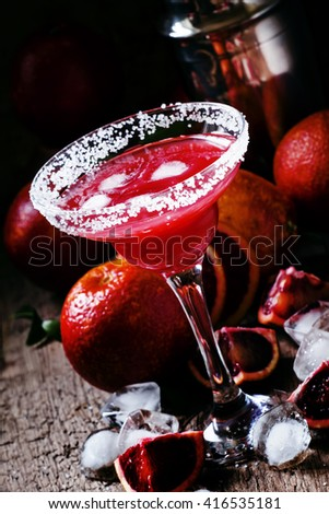Alcoholic cocktail Negroni with gin, Campari, red vermouth, blood orange and ice cubes, black background, selective focus - stock photo