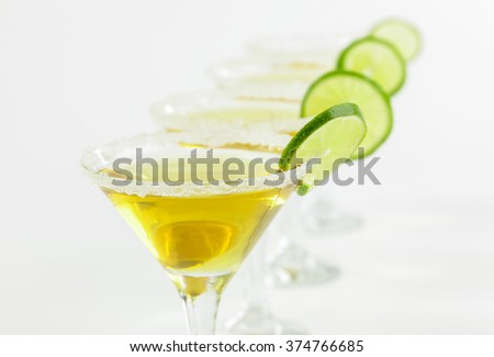 alcoholic cocktail with a slice of lime on white background - stock photo