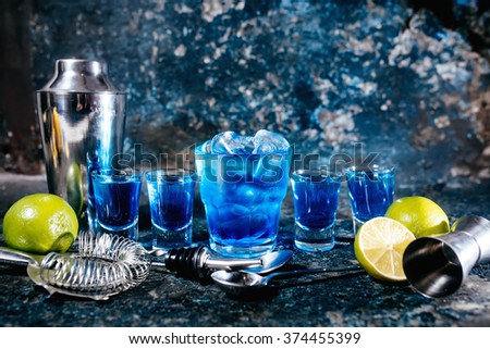 Alcoholic cocktails and garnish served cold at bar - stock photo