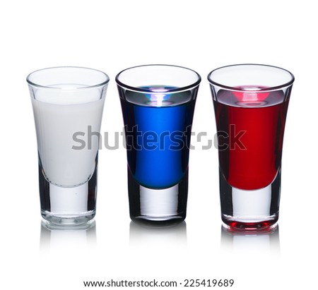 Alcoholic cocktails in shot glasses colored to resemble russian flag. - stock photo