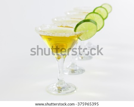 alcoholic cocktails with a slice of lime on white background - stock photo