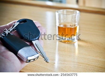 Alcoholic drink and car keys - do not drink and drive concept - stock photo