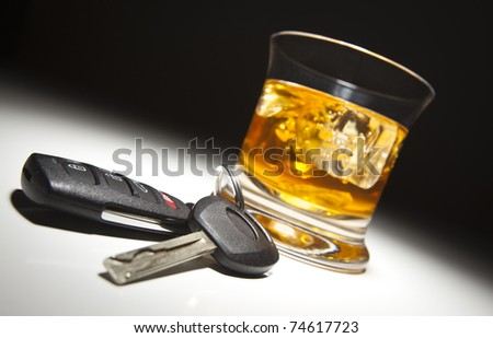 Alcoholic Drink and Car Keys Under Spot Light. - stock photo