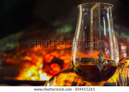 Alcoholic drink background with open fire . Whisky, whiskey, brandy, cognac, liqueur - stock photo